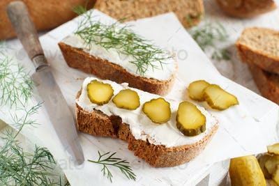 Sandwiches with cream cheese, dill and salted cucumber