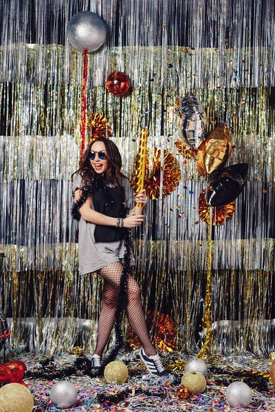 Portrait girl enjoying party and confetti