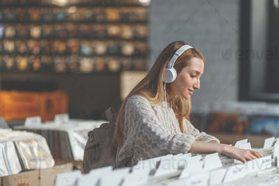 Young girl browsing records in a store