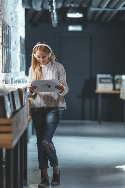 Young attractive girl in a music store