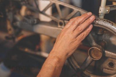 Man's hand in a factory machine