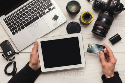 Photographer shopping online with digital tablet