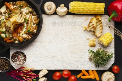 Meat stew, cooking ingredients on wooden cutting board, top view
