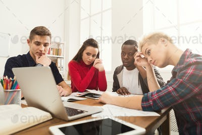 Multiethnic classmates preparing for exam together
