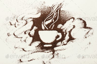 Drawing with ground coffee - cup and smoke, top view