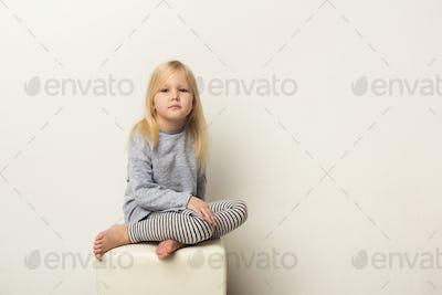 Cute happy little girl portrait in studio