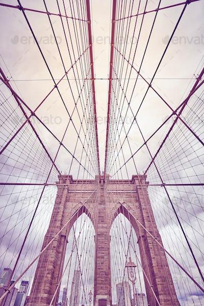 Looking up at the Brooklyn Bridge, New York.