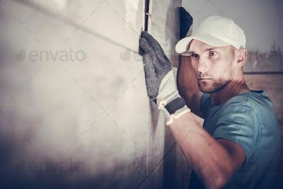 Contractor Installing Tiles
