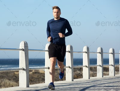 healthy young man going for a run outside
