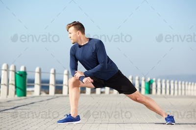 healthy young man stretching exercise outdoors