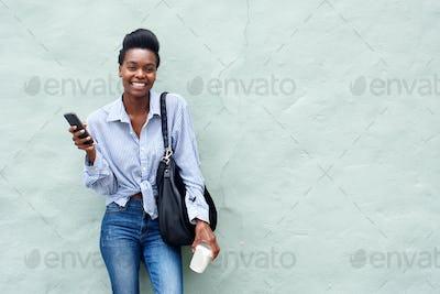 beautiful black woman holding cellphone