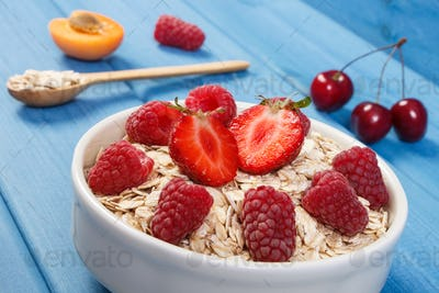 Oat flakes or oatmeal with strawberries and raspberries, healthy lifestyle and nutrition