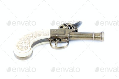Old gun on a white background