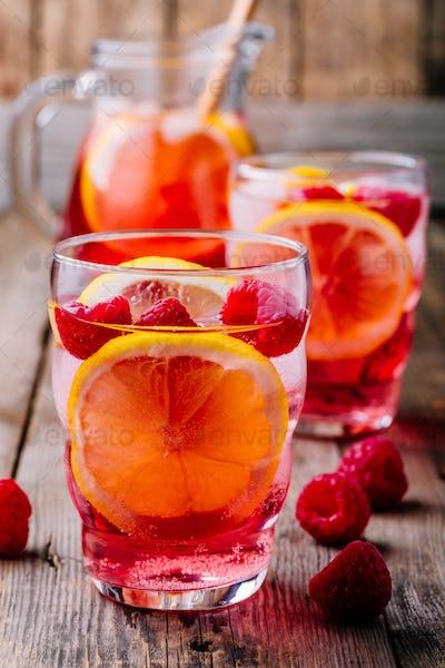Sparkling Lemon Raspberry Lemonade Sangria in glass on wooden background