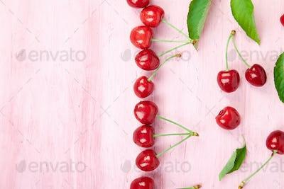 Ripe cherry berries and cherry  leaf