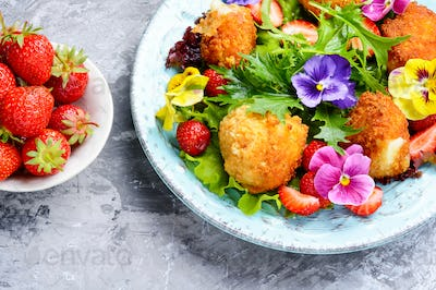 Salad leaves with strawberries,herbs and flowers