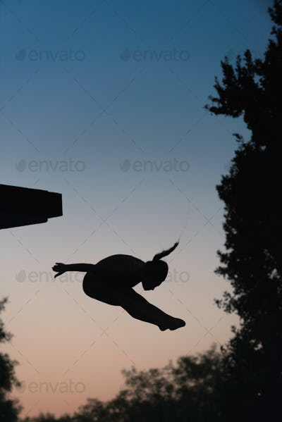 Female diver in the air