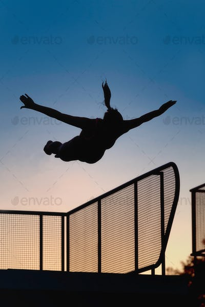 Jump from diving board in dusk