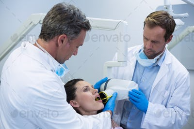 Dentists taking x-ray of patients teeth