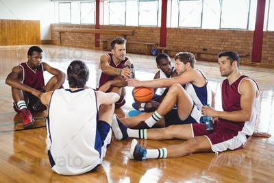 Basketball players interacting while relaxing