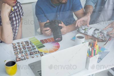 Team of photographers working together at desk