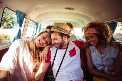 Group of friends having fun in campervan
