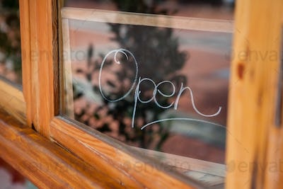 Close up of open text on glass window