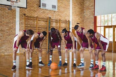 Basketball players taking a break on basketball court