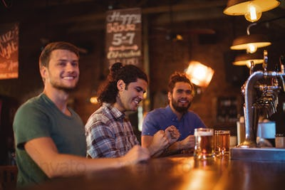 Group of male friends watching football match