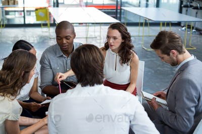 Business executives discussing during meeting