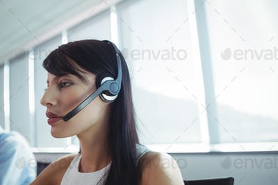 Close up of businesswoman using headset