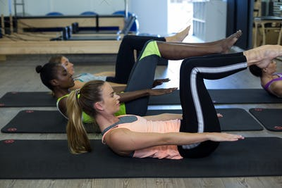 Women performing stretching exercise