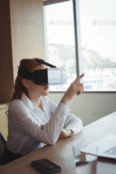 Businesswoman anticipating while using virtual reality technology at office
