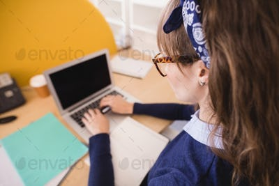 High angle view of businesswoman working at desk in office
