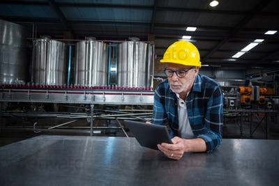 Factory worker using digital tablet