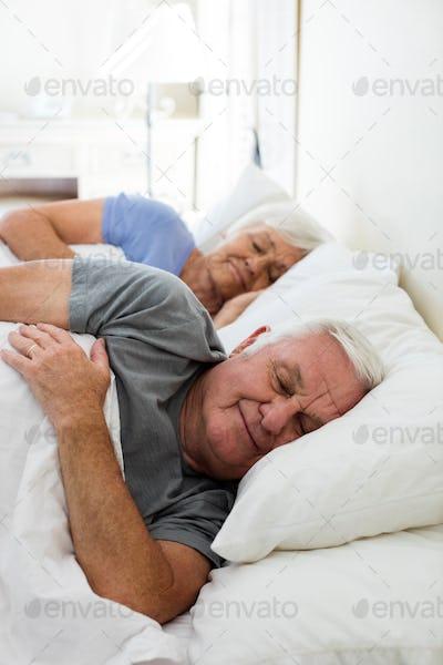 Senior couple sleeping in the bedroom
