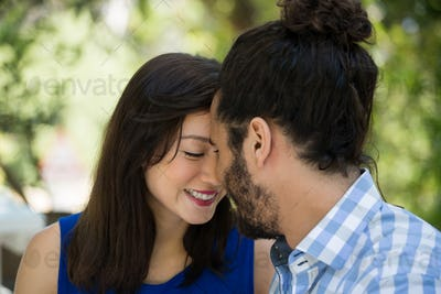 Romantic couple spending leisure time in park