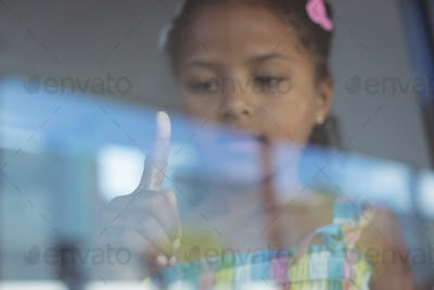 Girl touching window glass