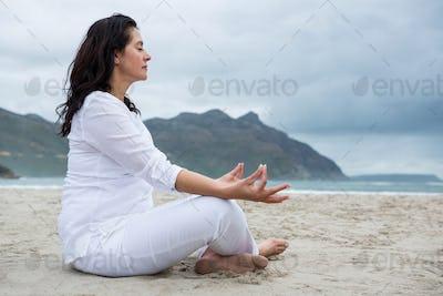 Beautiful woman performing yoga