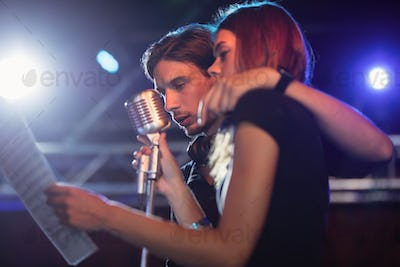 Male and female singers performing at nightclub