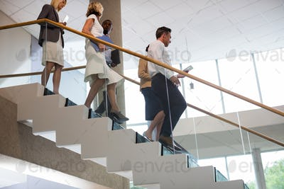Business executives walking down the stairs