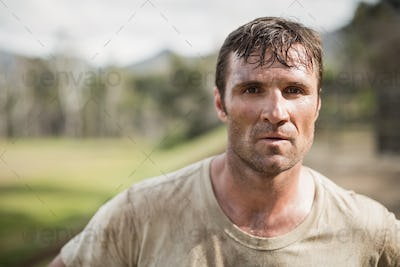 Military man standing during obstacle course in boot camp