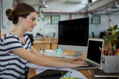 Female graphic designer using laptop
