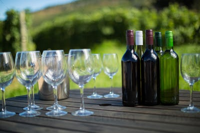 Wineglasses and bottles on table