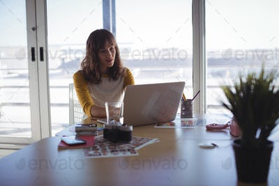 Young businesswoman working on laptop at office
