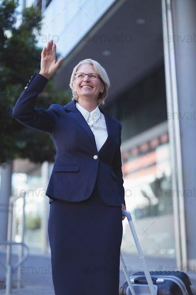 Smiling businesswoman gesturing