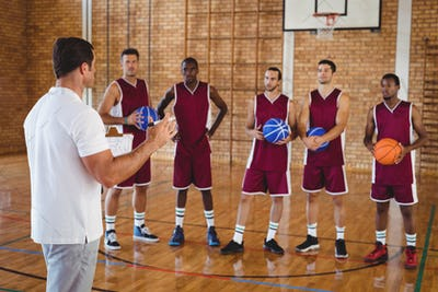 Basketball coach interacting with players