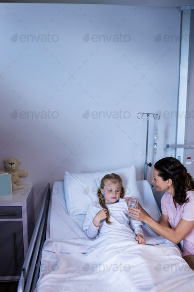 Female doctor giving medicine to patient