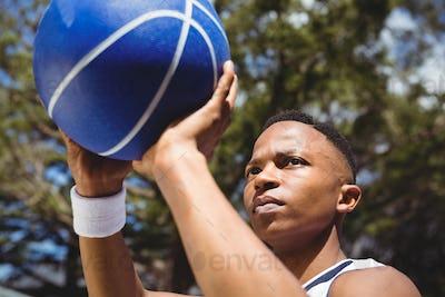 Close up of teenage boy practicing basketball
