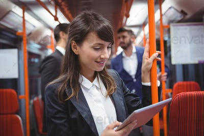 Executive using digital tablet in train